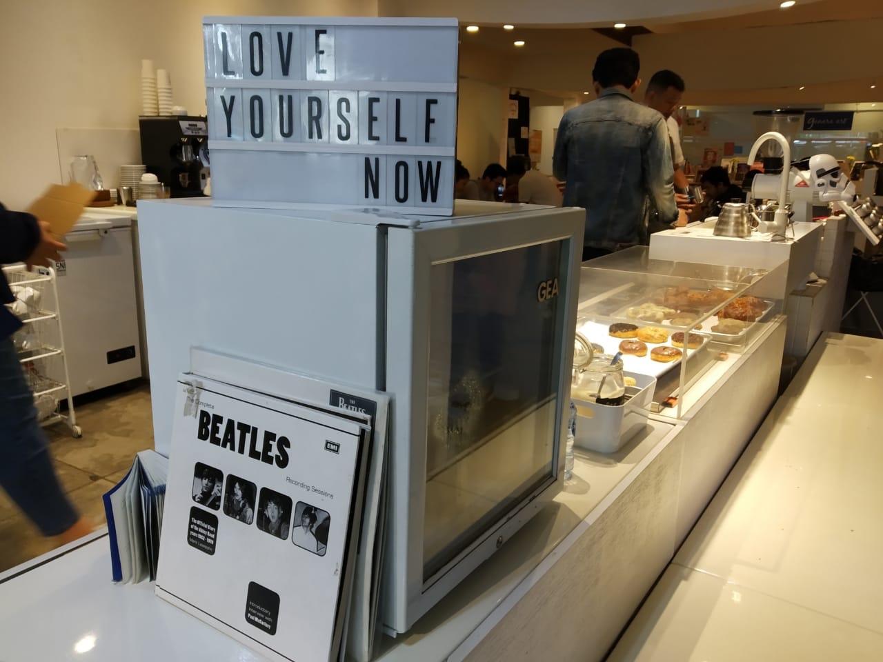 Love yourself and The Beatles from Ruang Seduh Coffeeshop, Aksara Kemang